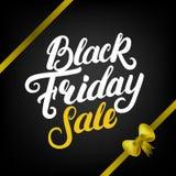 Black Friday sprzedaży ręka pisać literowanie z żółtym faborkiem i łękiem Zdjęcia Stock