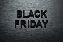 Black Friday sul fondo scuro dell'ardesia Fotografia Stock Libera da Diritti