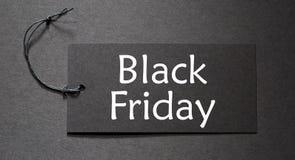 Black Friday tekst na czarnej etykietce Fotografia Stock