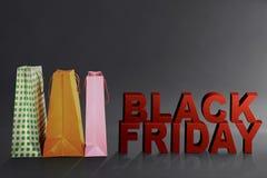 Black Friday tekst z kolorową papierową torbą Obrazy Royalty Free
