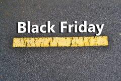Black Friday Text on Asphalt Street Royalty Free Stock Image