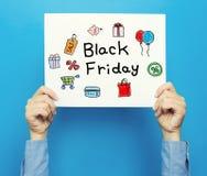 Black Friday-Text auf einem weißen Plakat Stockfotografie