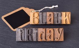 Black Friday Text. With blank price tag on a black background Royalty Free Stock Image