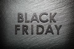 Black Friday text on black slate. Background Royalty Free Stock Images