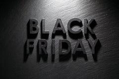 Black Friday text on black slate. Background Royalty Free Stock Photography