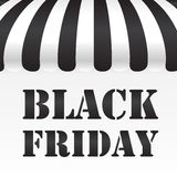 Black Friday text on black and white awning Royalty Free Stock Image