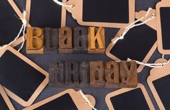 Black Friday Text. With blank price tags on a black background Royalty Free Stock Image