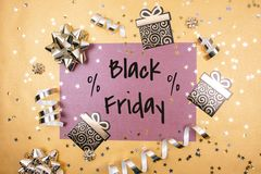 Black friday text on a gold background. Stock Images