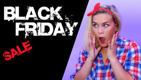 Black friday text next to surprished shocked retro styled woman Stock Image