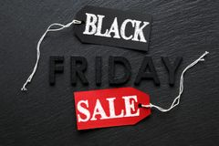 Black Friday text with red sale tag on slate. Background Royalty Free Stock Photos