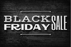 Black friday text on vector wooden background Stock Image
