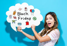 Black Friday text with young woman holding a speech bubble Royalty Free Stock Photos