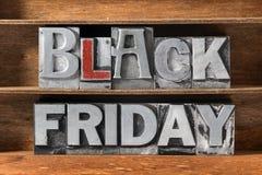 Black Friday tray. Black Friday phrase made from metallic letterpress type on wooden tray stock photos