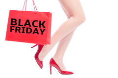 Black Friday for women shoes concept. With legs and shopping bag royalty free stock photography