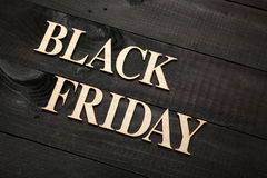 Black Friday. Wooden letters forming words BLACK FRIDAY written on black wooden background Royalty Free Stock Photos