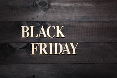 Black Friday. Wooden letters forming words BLACK FRIDAY written on black wooden background stock photos