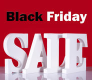 Black Friday Wooden Sale Letters on Red Background. Stock Photo