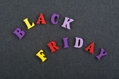BLACK FRIDAY word on black board background composed from colorful abc alphabet block wooden letters, copy space for ad. Word on black board background composed stock images
