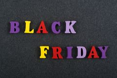 BLACK FRIDAY word on black board background composed from colorful abc alphabet block wooden letters, copy space for ad. Word on black board background composed royalty free stock photos