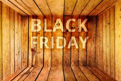 Black friday word in empty wood box. Lower the price of the warehouse Stock Image