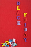 BLACK FRIDAY word on red background composed from colorful abc alphabet block wooden letters, copy space for ad text. Word on red background composed from stock photography