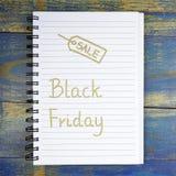 Black Friday written in notebook Stock Photos