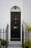 Black front door. The picture was taken in London Stock Image