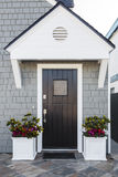 Black front door of home with eave stock images