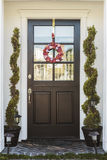 Black front door of home with heart wreath Royalty Free Stock Images