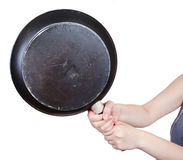 Black frying pan in female hands Royalty Free Stock Image