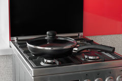 Black frying pan on a gas stove Royalty Free Stock Images