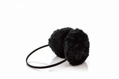 Black fuzzy winter ear muff . Royalty Free Stock Images