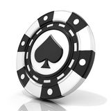 Black gambling chip with spade sign on it Royalty Free Stock Photo