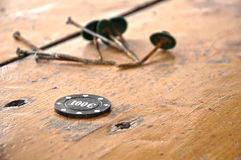 Black gambling chip,on wooden table. Abstract Royalty Free Stock Photo