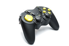 Black game controller with yellow buttons. Royalty Free Stock Photo