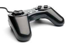 Black gamepad. Isolated black wired gamepad on white background Royalty Free Stock Photo