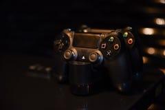 Black gamepad on a dark background. Black gamepad on a black background in wooden table Stock Photo