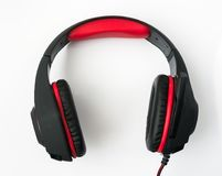 black gaming headphones with cord on white background Stock Image