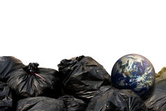 Black garbage bags and the earth Stock Photography