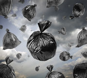 Black garbage bags in the stormy sky. Stock Images