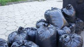 Black garbage bags stock video footage
