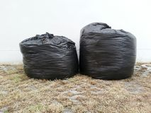 Black garbage bags Stock Images