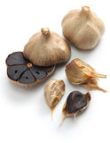 Black garlic bulbs and cloves Stock Photography