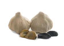 Black garlic whole and cloves Stock Image