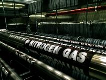 Black gas pipe line under raised floor. Fuel and energy industrial concept royalty free stock photos