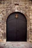 Black gate. Shot of black gate in the Kotor city, Montenegro Royalty Free Stock Image