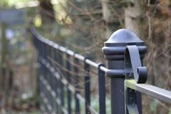 Black gate post and gate with scrolling feature Stock Images