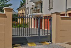 a black gate of a residence, horizontal picture Stock Photos