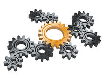 Black gears and one orange. Teamwork and leadership concept. Royalty Free Stock Image