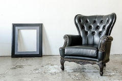 Black genuine leather classical style sofa Stock Photos